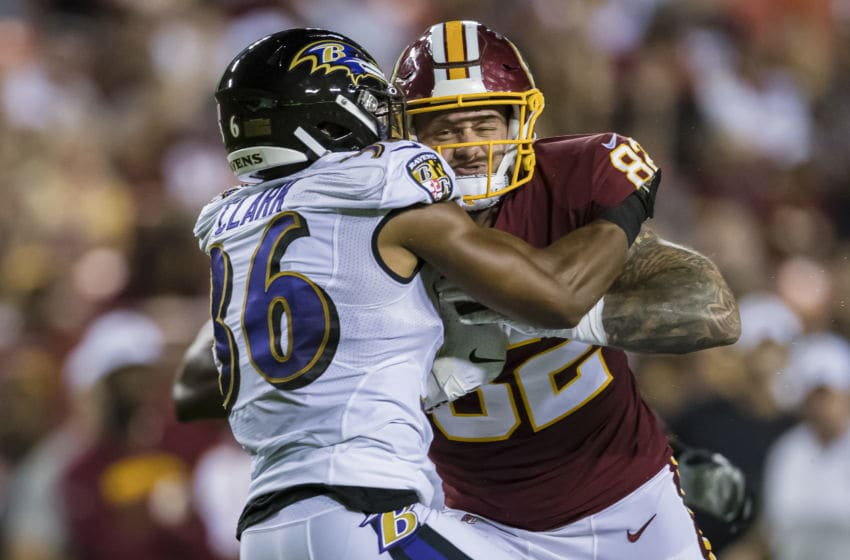 LANDOVER, MD - AUGUST 29: Nick Boyle #86 of the Baltimore Ravens tackles J.P. Holtz #82 of the Washington Redskins during the first half of a preseason game at FedExField on August 29, 2019 in Landover, Maryland. (Photo by Scott Taetsch/Getty Images)