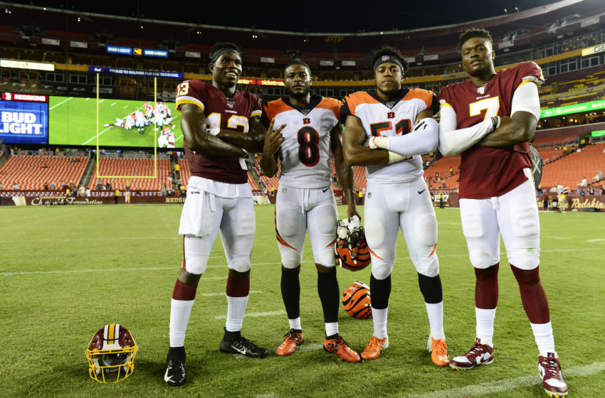 LANDOVER, MD - AUGUST 15: Dwayne Haskins #7 and Kelvin Harmon #13 of the Washington Redskins take a photo with Stanley Morgan #8 and Sterling Sheffield #51 of the Cincinnati Bengals after a preseason game at FedExField on August 15, 2019 in Landover, Maryland. The Bengals defeated the Redskins 23-13. (Photo by Patrick McDermott/Getty Images)