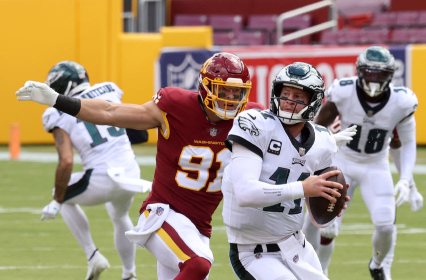 LANDOVER, MARYLAND - SEPTEMBER 13: Ryan Kerrigan #91 of the Washington Football Team sacks quarterback Carson Wentz #11 of the Philadelphia Eagles in the first half at FedExField on September 13, 2020 in Landover, Maryland. (Photo by Rob Carr/Getty Images)