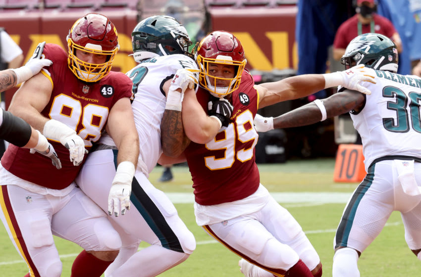 LANDOVER, MARYLAND - SEPTEMBER 13: Matthew Ioannidis #98 and Chase Young #99 of the Washington Football Team rush the Philadelphia Eagles offense at FedExField on September 13, 2020 in Landover, Maryland. (Photo by Rob Carr/Getty Images)