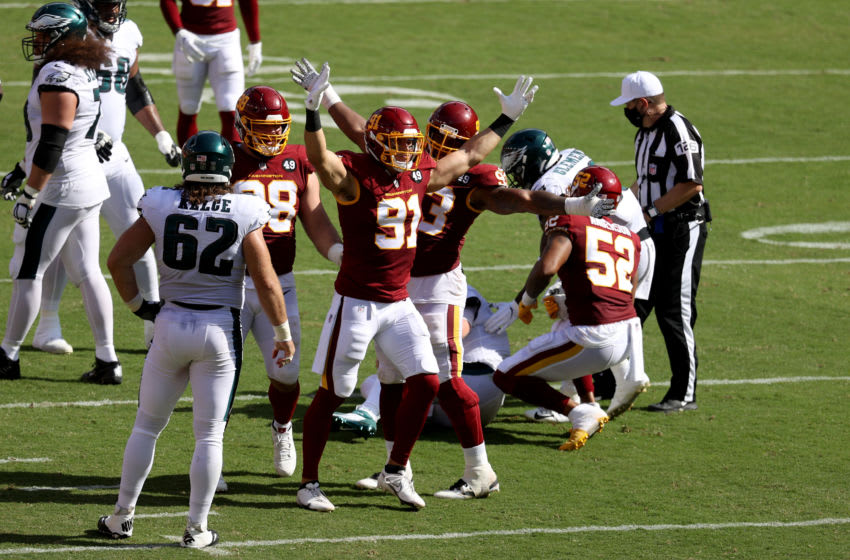 LANDOVER, MARYLAND - SEPTEMBER 13: Ryan Kerrigan #91 of the Washington Football Team celebrates after a play against the Philadelphia Eagles in the second half at FedExField on September 13, 2020 in Landover, Maryland. (Photo by Rob Carr/Getty Images)
