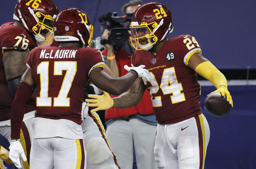 ARLINGTON, TEXAS - NOVEMBER 26: Antonio Gibson #24 of the Washington Football Team celebrates with Terry McLaurin #17 after rushing for a 23-yard touchdown during the fourth quarter of a game against the Dallas Cowboys at AT&T Stadium on November 26, 2020 in Arlington, Texas. (Photo by Tom Pennington/Getty Images)