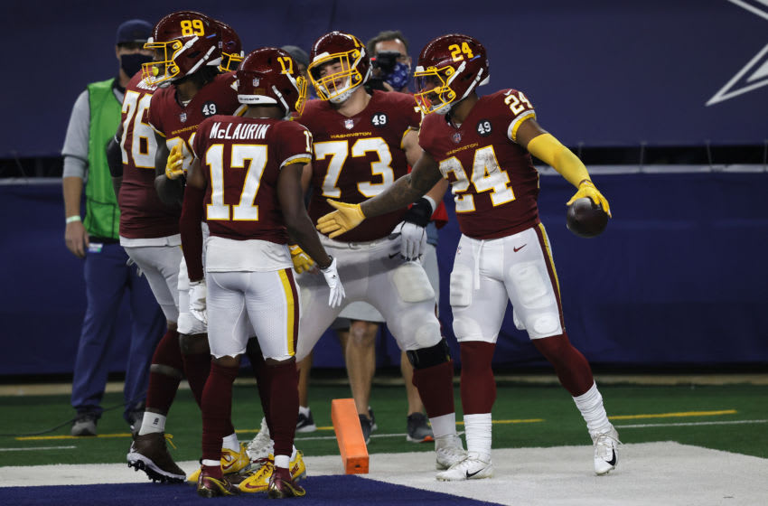 ARLINGTON, TEXAS - NOVEMBER 26: Antonio Gibson #24 of the Washington Football Team celebrates with Terry McLaurin #17, Chase Roullier #73 and Morgan Moses #76 after rushing for a 23-yard touchdown during the fourth quarter of a game against the Dallas Cowboys at AT&T Stadium on November 26, 2020 in Arlington, Texas. (Photo by Tom Pennington/Getty Images)