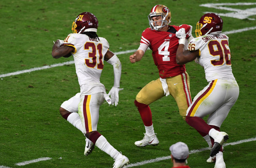 GLENDALE, ARIZONA - DECEMBER 13: Strong safety Kamren Curl #31 of the Washington Football Team runs for a touchdown on an interception thrown by quarterback Nick Mullens #4 of the San Francisco 49ers in the third quarter of the game at State Farm Stadium on December 13, 2020 in Glendale, Arizona. (Photo by Norm Hall/Getty Images)