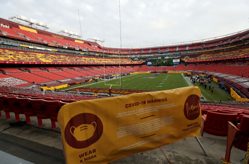 LANDOVER, MARYLAND - DECEMBER 20: A general view of FedExField with a Covid-19 sign during the Washington Football Team and Seattle Seahawks game on December 20, 2020 in Landover, Maryland. (Photo by Patrick Smith/Getty Images)
