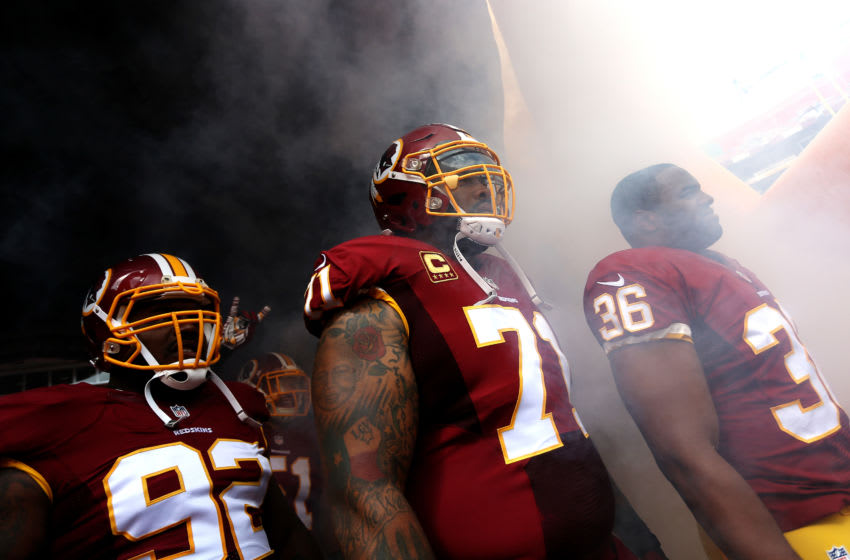 LANDOVER, MD - SEPTEMBER 20: Defensive back Tanard Jackson #36 of the Washington Redskins, nose tackle Chris Baker #92 of the Washington Redskins, inside linebacker Will Compton #51 of the Washington Redskins, and tackle Trent Williams #71 of the Washington Redskins prepare to run onto the field prior to the start of a game against the St. Louis Rams at FedExField on September 20, 2015 in Landover, Maryland. (Photo by Matt Hazlett/Getty Images)
