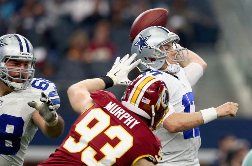 ARLINGTON, TX - JANUARY 03: Kellen Moore #17 of the Dallas Cowboys looks for an open receiver Trent Murphy #93 of the Washington Redskins in the fourth quarter at AT&T Stadium on January 3, 2016 in Arlington, Texas. (Photo by Tom Pennington/Getty Images)
