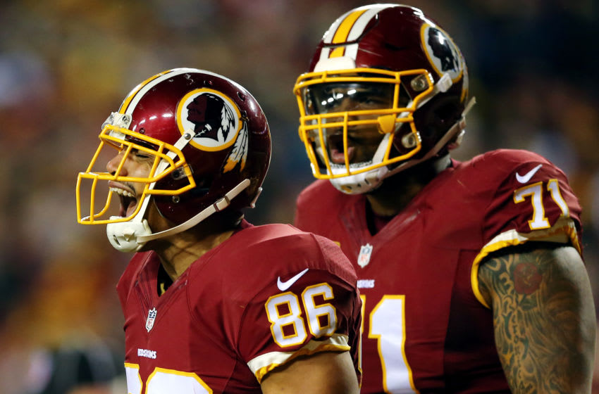 LANDOVER, MD - JANUARY 10: Tight end Jordan Reed #86 of the Washington Redskins celebrates with teammate tackle Trent Williams #71 after scoring a second-quarter touchdown against the Green Bay Packers during the NFC Wild Card Playoff game at FedExField on January 10, 2016 in Landover, Maryland.(Photo by Elsa/Getty Images)