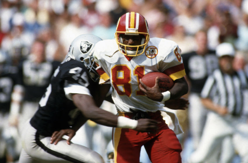 WASHINGTON, D.C. - CIRCA 1992: Wide Receiver Art Monk #81 of the Washington Redskins runs with the ball after catching a pass against the Los Angeles Raiders during an NFL game circa 1992 at RFK Stadium in Washington, D.C. Monk played for the Redskins from 1980-93. (Photo by Focus on Sport/Getty Images)