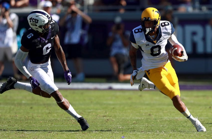 FORT WORTH, TX - OCTOBER 07: Marcus Simms #8 of the West Virginia Mountaineers carries the ball against Innis Gaines #6 of the TCU Horned Frogs in the first half at Amon G. Carter Stadium on October 7, 2017 in Fort Worth, Texas. (Photo by Tom Pennington/Getty Images)