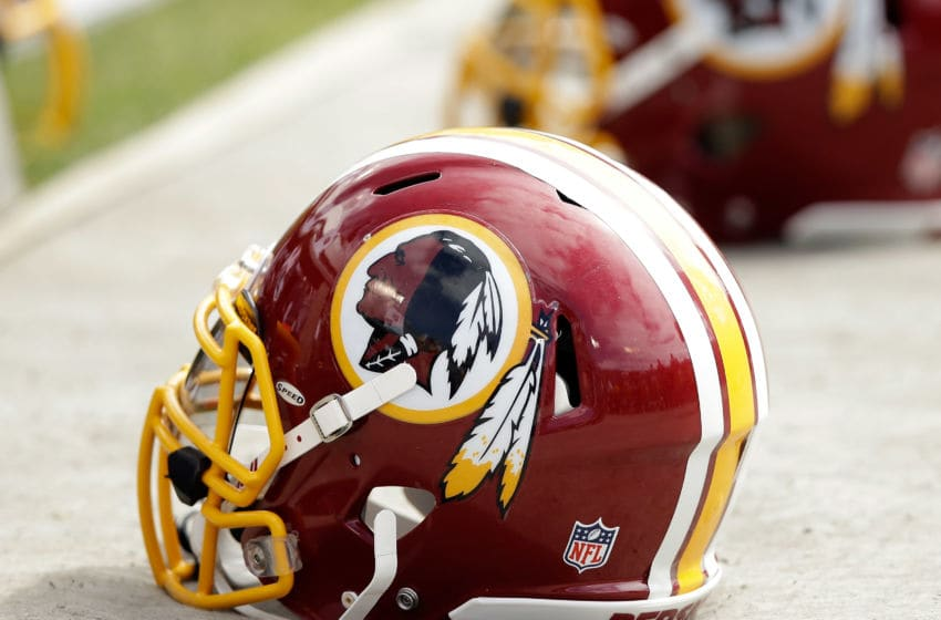 OAKLAND, CA - SEPTEMBER 29: Washington Redskins helmets lay on the ground during their game against the Oakland Raiders at O.co Coliseum on September 29, 2013 in Oakland, California. (Photo by Ezra Shaw/Getty Images)