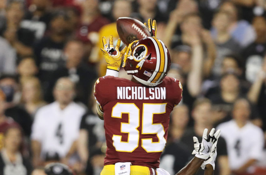 LANDOVER, MD - SEPTEMBER 24: Strong safety Montae Nicholson #35 of the Washington Redskins makes an interception over wide receiver Amari Cooper #89 of the Oakland Raiders in the first quarter at FedExField on September 24, 2017 in Landover, Maryland. (Photo by Patrick Smith/Getty Images)