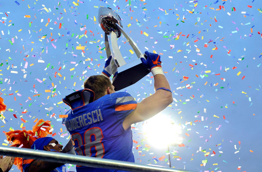 LAS VEGAS, NV - DECEMBER 16: Leighton Vander Esch #38 of the Boise State Broncos celebrates with the trophy after the Broncos defeated the Oregon Ducks in the Las Vegas Bowl at Sam Boyd Stadium on December 16, 2017 in Las Vegas, Nevada. Boise State won 38-28. (Photo by David Becker/Getty Images)