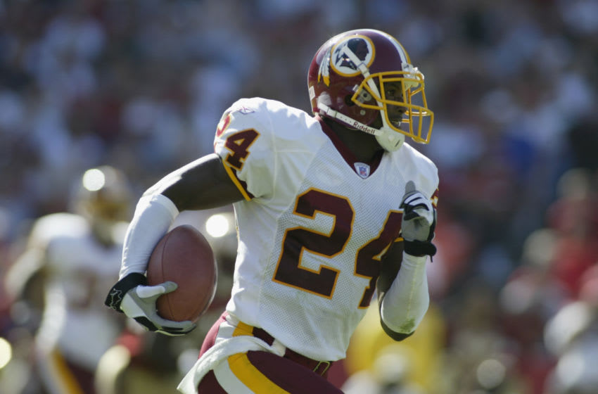 SAN FRANCISCO - SEPTEMBER 22: Cornerback Champ Bailey #24 of the Washington Redskins runs the ball against the San Francisco 49ers during the NFL game on September 22, 2002 at Candlestick Park in San Francisco, California. The 49er's won 20-10. (Photo by Jed Jacobsohn/Getty Images)