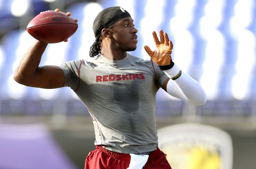 BALTIMORE, MD - AUGUST 29: Quarterback Robert Griffin III #10 of the Washington Redskins warms up prior to the start of a preseason game against the Baltimore Ravens at M&T Bank Stadium on August 29, 2015 in Baltimore, Maryland. (Photo by Matt Hazlett/ Getty Images)