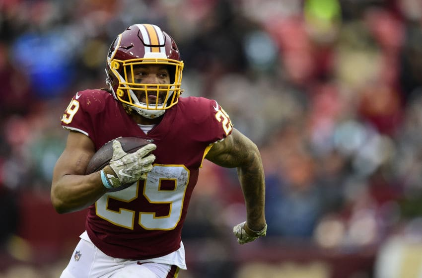 LANDOVER, MD - NOVEMBER 17: Derrius Guice #29 of the Washington Football Team scores a 45-yard touchdown in the second half against the New York Jets at FedExField on November 17, 2019 in Landover, Maryland. (Photo by Patrick McDermott/Getty Images)