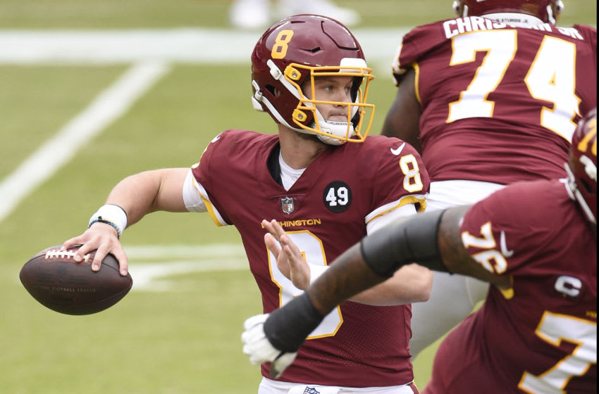 LANDOVER, MARYLAND - OCTOBER 11: Kyle Allen #8 of the Washington Football Team throws a pass against the Los Angeles Rams in the first half at FedExField on October 11, 2020 in Landover, Maryland. (Photo by Patrick McDermott/Getty Images)