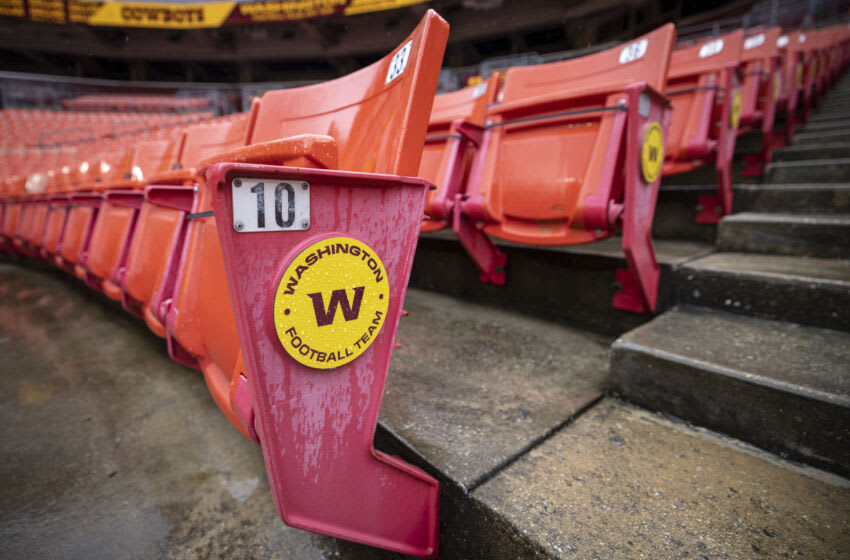 LANDOVER, MD - OCTOBER 25: A general view of an empty section of seats with a Washington Football Team logo before the game between the Washington Football Team and the Dallas Cowboys at FedExField on October 25, 2020 in Landover, Maryland. A limited number of friends and family were allowed to attend the game due to the novel coronavirus (COVID-19) pandemic. (Photo by Scott Taetsch/Getty Images)