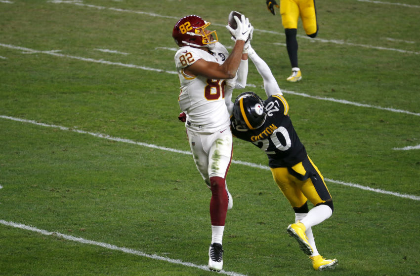PITTSBURGH, PENNSYLVANIA - DECEMBER 07: Logan Thomas #82 of the Washington Football Team catches a pass against Cameron Sutton #20 of the Pittsburgh Steelers during the second half of their game at Heinz Field on December 07, 2020 in Pittsburgh, Pennsylvania. (Photo by Justin K. Aller/Getty Images)