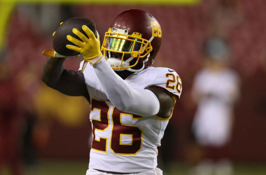 LANDOVER, MARYLAND - SEPTEMBER 16: Landon Collins #26 of the Washington Football Team warms up prior to facing the New York Giants at FedExField on September 16, 2021 in Landover, Maryland. (Photo by Patrick Smith/Getty Images)