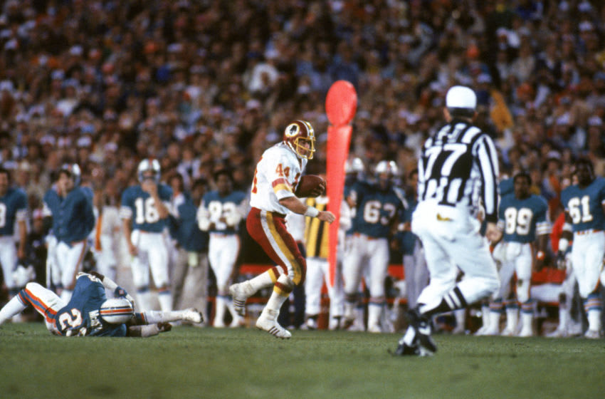 PASADENA, CA - JANUARY 30: Running back John Riggins #44 of the Washington Redskins rushes for yards during Super Bowl XVII against the Miami Dolphins at the Rose Bowl on January 30, 1983 in Pasadena, California. John Riggins was named Super Bowl MVP as the Redskins won 27-17. (Photo by Getty Images)