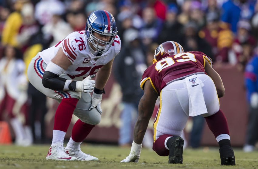 LANDOVER, MD - DECEMBER 22: Nate Solder #76 of the New York Giants lines up against Jonathan Allen #93 of the Washington football team during the second half at FedExField on December 22, 2019 in Landover, Maryland. (Photo by Scott Taetsch/Getty Images)