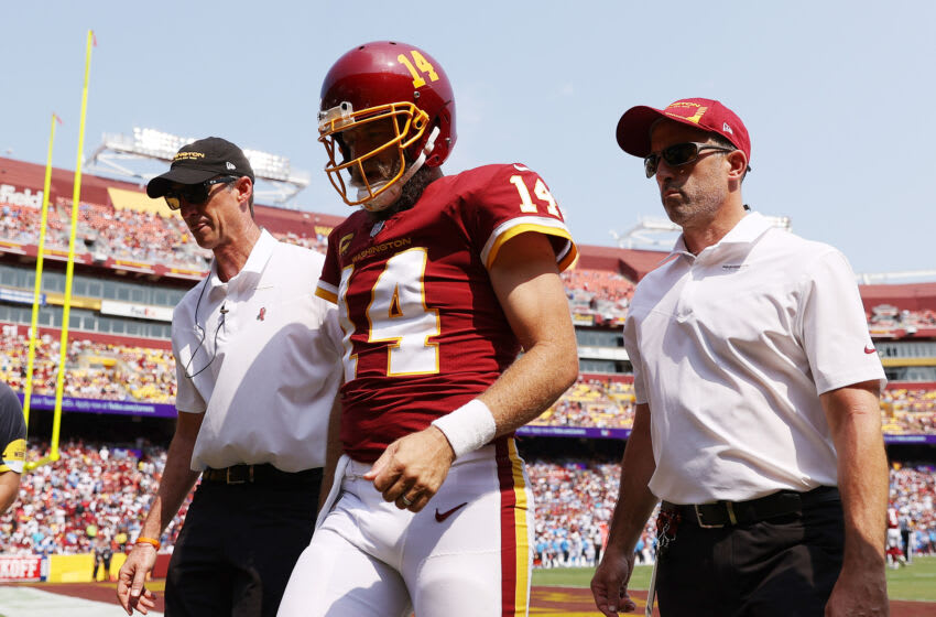 LANDOVER, MARYLAND - SEPTEMBER 12: Ryan Fitzpatrick #14 of the Washington Football Team reacts as he is taken off the field after being injured against the Los Angeles Chargers during the second quarter at FedExField on September 12, 2021 in Landover, Maryland. (Photo by Patrick Smith/Getty Images)