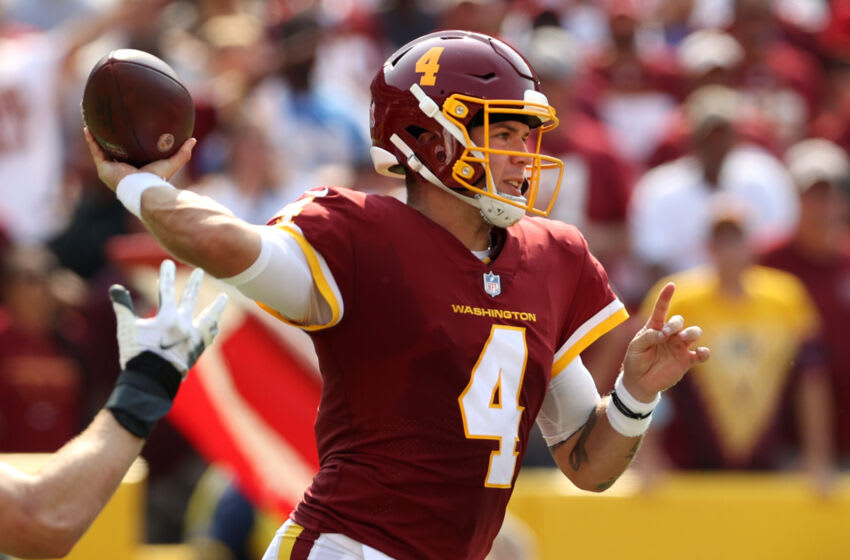 LANDOVER, MARYLAND - SEPTEMBER 12: Taylor Heinicke #4 of the Washington Football Team throws a pass against the Los Angeles Chargers during the third quarter at FedExField on September 12, 2021 in Landover, Maryland. (Photo by Rob Carr/Getty Images)