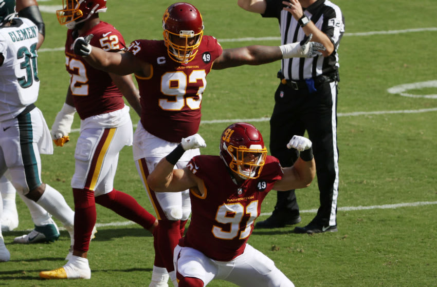 Sep 13, 2020; Landover, Maryland, USA; Washington Football Team defensive end Ryan Kerrigan (91) celebrates in front of Washington Football Team defensive tackle Jonathan Allen (93) after a sack against the Philadelphia Eagles in the third quarter at FedExField. Mandatory Credit: Geoff Burke-USA TODAY Sports