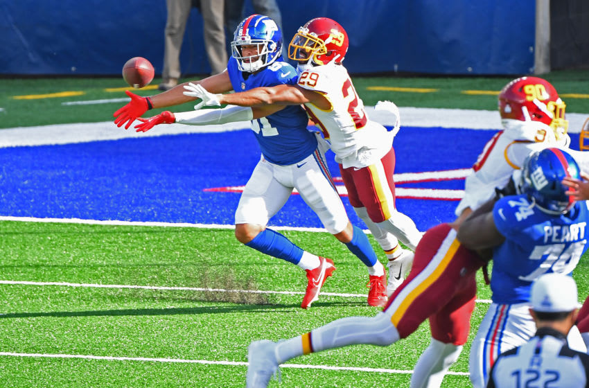Oct 18, 2020; East Rutherford, New Jersey, USA; New York Giants wide receiver Austin Mack (81) draws a pass interference call on Washington Football Team cornerback Kendall Fuller (29) late in the third quarter at MetLife Stadium. Mandatory Credit: Robert Deutsch-USA TODAY Sports