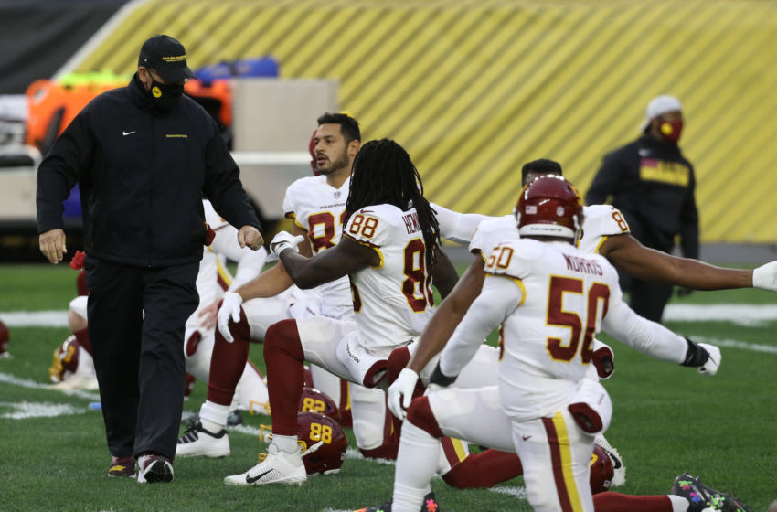 Dec 7, 2020; Pittsburgh, Pennsylvania, USA; Washington Football Team head coach Ron Rivera (left) greets his players before the game against the Pittsburgh Steelers at Heinz Field. Mandatory Credit: Charles LeClaire-USA TODAY Sports
