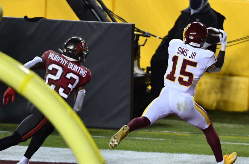 Jan 9, 2021; Landover, Maryland, USA; Washington Football Team wide receiver Steven Sims Jr. (15) catches a touchdown as Tampa Bay Buccaneers cornerback Sean Murphy-Bunting (23) defends during the fourth quarter at FedExField. Mandatory Credit: Brad Mills-USA TODAY Sports