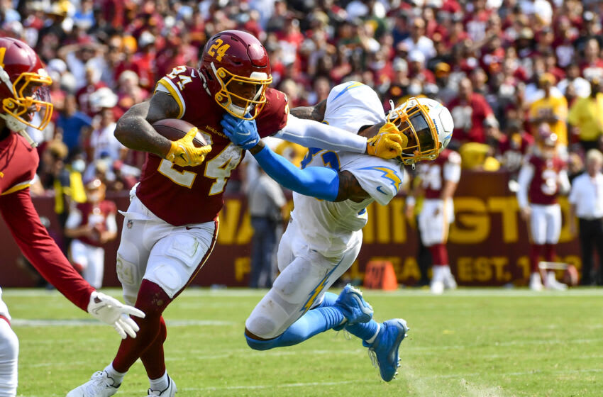 Sep 12, 2021; Landover, Maryland, USA; Washington Football Team running back Antonio Gibson (24) is called for a facemark and Los Angeles Chargers free safety Derwin James (33) is called for a horse collar tackle during the second half at FedExField. Mandatory Credit: Brad Mills-USA TODAY Sports