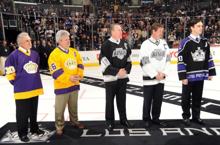 LOS ANGELES - APRIL 4: Former Los Angeles Kings (L-R) Rogie Vachon, Marcel Dionne, Dave Taylor, Wayne Gretzky and Luc Robitaille stand on the ice for a presentation prior to the game on April 4, 2009 at Staples Center in Los Angeles, California. (Photo by Andrew D. Bernstein/NHLI via Getty Images)