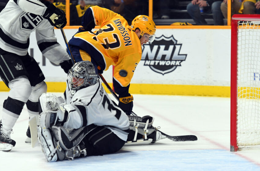 Feb 1, 2018; Nashville, TN, USA; Los Angeles Kings goalie Jonathan Quick (32) allows a goal to Nashville Predators right wing Craig Smith (not pictured) as left wing Viktor Arvidsson (33) moves in position during the first period at Bridgestone Arena. Mandatory Credit: Christopher Hanewinckel-USA TODAY Sports