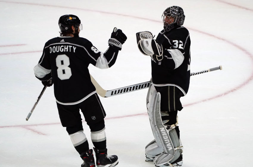 Apr 7, 2021; Los Angeles, California, USA; Los Angeles Kings defenseman Drew Doughty (8) and goaltender Jonathan Quick (32) celebrate the 4-3 victory against the Arizona Coyotes at Staples Center. Mandatory Credit: Gary A. Vasquez-USA TODAY Sports