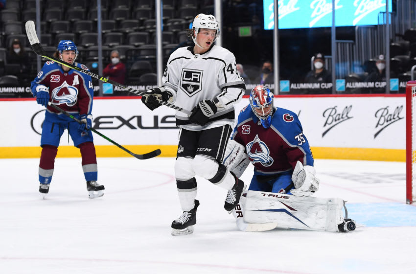 May 13, 2021; Denver, Colorado, USA; Colorado Avalanche goaltender Jonas Johansson (35) makes a save in front of Los Angeles Kings center Drake Rymsha (43) in the first period at Ball Arena. Mandatory Credit: Ron Chenoy-USA TODAY Sports