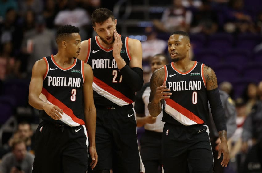 PHOENIX, AZ - OCTOBER 05: Damian Lillard #0 (R) of the Portland Trail Blazers talks with CJ McCollum #3 and Jusuf Nurkic #27 during the first half of the NBA preseason game against the Phoenix Suns at Talking Stick Resort Arena on October 5, 2018 in Phoenix, Arizona. NOTE TO USER: User expressly acknowledges and agrees that, by downloading and or using this photograph, User is consenting to the terms and conditions of the Getty Images License Agreement. (Photo by Christian Petersen/Getty Images)