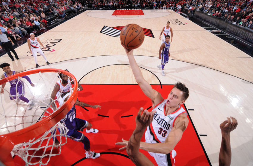 PORTLAND, OR - OCTOBER 12: Zach Collins #33 of the Portland Trail Blazers shoots the ball against the Sacramento Kings during a pre-season game on October 12, 2018 at Moda Center, in Portland, Oregon. NOTE TO USER: User expressly acknowledges and agrees that, by downloading and/or using this Photograph, user is consenting to the terms and conditions of the Getty Images License Agreement. Mandatory Copyright Notice: Copyright 2018 NBAE (Photo by Sam Forencich/NBAE via Getty Images)