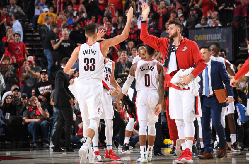 PORTLAND, OR - OCTOBER 18: Zach Collins #33 and Jusuf Nurkic #27 of the Portland Trail Blazers high five against the Los Angeles Lakers on October 18, 2018 at the Moda Center Arena in Portland, Oregon. NOTE TO USER: User expressly acknowledges and agrees that, by downloading and or using this photograph, user is consenting to the terms and conditions of the Getty Images License Agreement. Mandatory Copyright Notice: Copyright 2018 NBAE (Photo by Andrew D. Bernstein/NBAE via Getty Images)