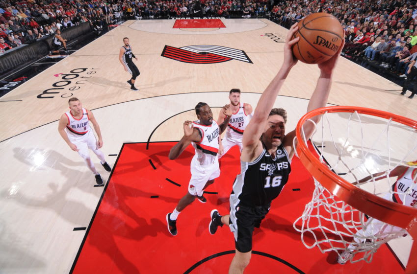 PORTLAND, OR - OCTOBER 20: Pau Gasol #16 of the San Antonio Spurs shoots the ball against the Portland Trail Blazers on October 20, 2018 at the Moda Center in Portland, Oregon. NOTE TO USER: User expressly acknowledges and agrees that, by downloading and or using this Photograph, user is consenting to the terms and conditions of the Getty Images License Agreement. Mandatory Copyright Notice: Copyright 2018 NBAE (Photo by Sam Forencich/NBAE via Getty Images)