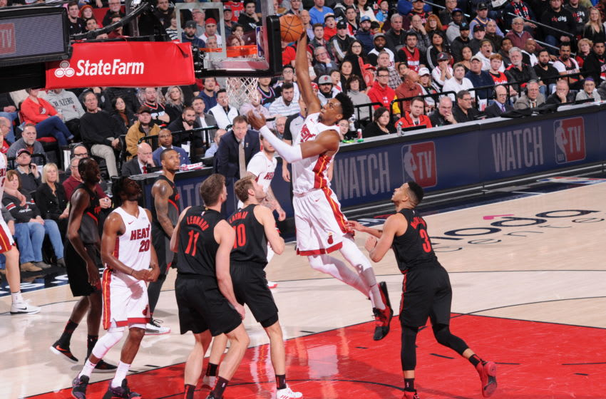 PORTLAND, OR - FEBRUARY 5: Hassan Whiteside #21 of the Miami Heat dunks the ball against the Portland Trail Blazers on February 5, 2019 at the Moda Center Arena in Portland, Oregon. NOTE TO USER: User expressly acknowledges and agrees that, by downloading and or using this photograph, user is consenting to the terms and conditions of the Getty Images License Agreement. Mandatory Copyright Notice: Copyright 2019 NBAE (Photo by Sam Forencich/NBAE via Getty Images)