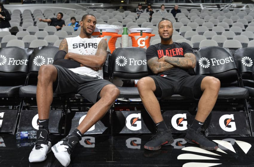 SAN ANTONIO, TX - MARCH 16: LaMarcus Aldridge #12 of the San Antonio Spurs and Damian Lillard #0 of the Portland Trail Blazers talks before the game on March 16, 2019 at the AT&T Center in San Antonio, Texas. NOTE TO USER: User expressly acknowledges and agrees that, by downloading and or using this photograph, user is consenting to the terms and conditions of the Getty Images License Agreement. Mandatory Copyright Notice: Copyright 2019 NBAE (Photos by Mark Sobhani/NBAE via Getty Images)