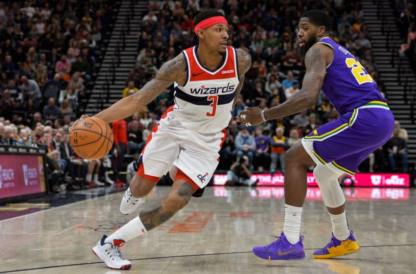 Bradley Beal #3 of the Washington Wizards drives past Royce O'Neale #23 of the Utah Jazz (Photo by Alex Goodlett/Getty Images)