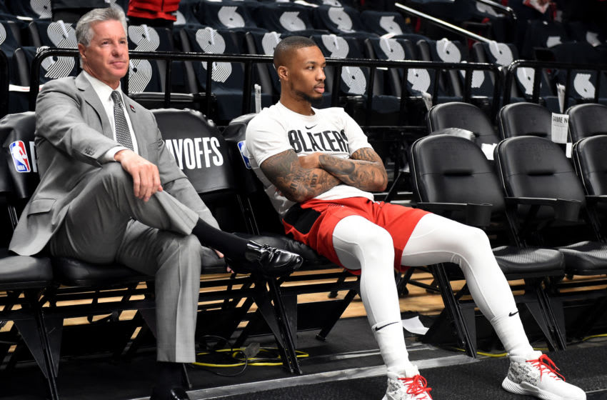 PORTLAND, OREGON - MAY 09: General Manager Neil Olshey of the Portland Trail Blazers sits with Damian Lillard #0 during warmups before Game Six of the Western Conference Semifinals at Moda Center on May 09, 2019 in Portland, Oregon. NOTE TO USER: User expressly acknowledges and agrees that, by downloading and or using this photograph, User is consenting to the terms and conditions of the Getty Images License Agreement. (Photo by Steve Dykes/Getty Images) (Photo by Steve Dykes/Getty Images)