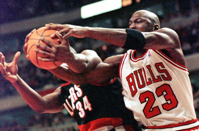Michael Jordan, Chicago Bulls and Isaiah Rider, Portland Trail Blazers (Photo credit should read VINCENT LAFORET/AFP via Getty Images)