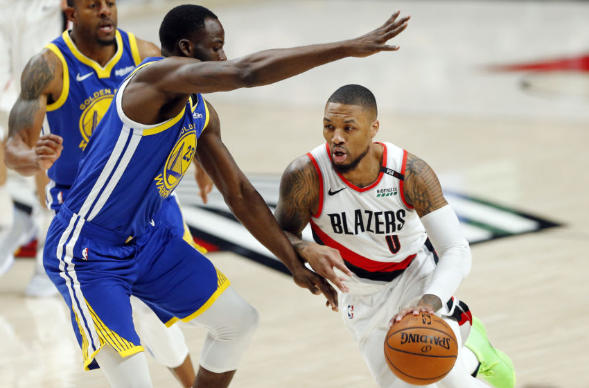 PORTLAND, OREGON - MAY 18: Damian Lillard #0 of the Portland Trail Blazers dribbles against Draymond Green #23 of the Golden State Warriors during the first half in game three of the NBA Western Conference Finals at Moda Center on May 18, 2019 in Portland, Oregon. NOTE TO USER: User expressly acknowledges and agrees that, by downloading and or using this photograph, User is consenting to the terms and conditions of the Getty Images License Agreement. (Photo by Jonathan Ferrey/Getty Images)
