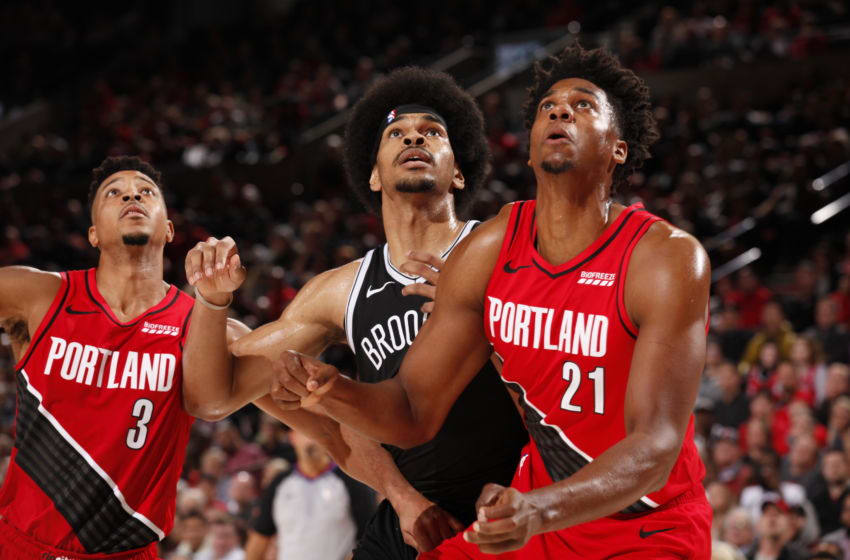 PORTLAND, OR - NOVEMBER 8: CJ McCollum #3 of the Portland Trail Blazers, Jarrett Allen #31 of the Brooklyn Nets, and Hassan Whiteside #21 of the Portland Trail Blazers look on on November 8, 2019 at the Moda Center Arena in Portland, Oregon. NOTE TO USER: User expressly acknowledges and agrees that, by downloading and or using this photograph, user is consenting to the terms and conditions of the Getty Images License Agreement. Mandatory Copyright Notice: Copyright 2019 NBAE (Photo by Cameron Browne/NBAE via Getty Images)