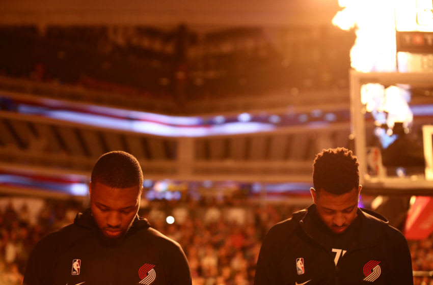 SACRAMENTO, CALIFORNIA - OCTOBER 25: Damian Lillard #0 and CJ McCollum #3 of the Portland Trail Blazers stand on the court for the National Anthem before their game against the Sacramento Kings at Golden 1 Center on October 25, 2019 in Sacramento, California. NOTE TO USER: User expressly acknowledges and agrees that, by downloading and or using this photograph, User is consenting to the terms and conditions of the Getty Images License Agreement. (Photo by Ezra Shaw/Getty Images)