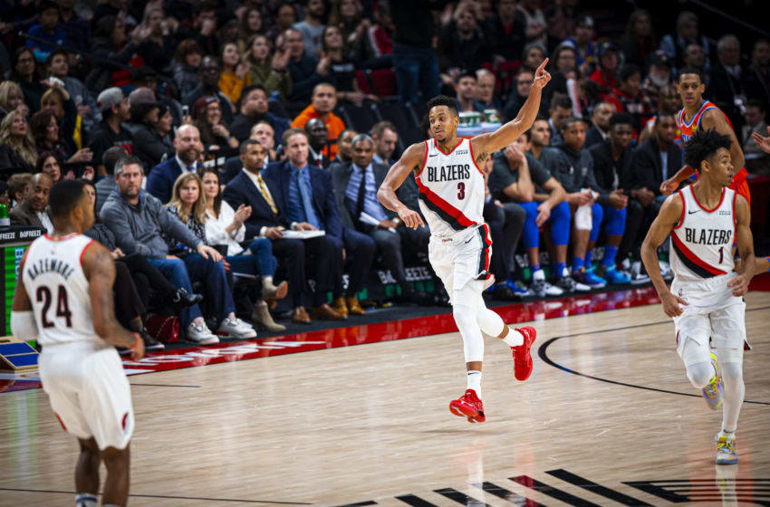 PORTLAND, OR - DECEMBER 8: CJ McCollum #3 of the Portland Trail Blazers celebrates a shot against the Oklahoma City Thunder on December 8, 2019 at Moda Center in Portland, Oregon. NOTE TO USER: User expressly acknowledges and agrees that, by downloading and or using this Photograph, User is consenting to the terms and conditions of the Getty Images License Agreement. Mandatory Copyright Notice: Copyright 2019 NBAE (Photo by Zach Beeker/NBAE via Getty Images)
